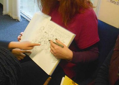 Katy Dynes Author signing, reading and Illustrating at Rushmoor (photo by Heather Bushell)