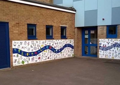 Long view of the 5m and 4m mural walls at Hazeldene School by Katy Dynes
