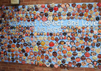 Painted Clay Faces at St Monica's School by the children and Katy Dynes